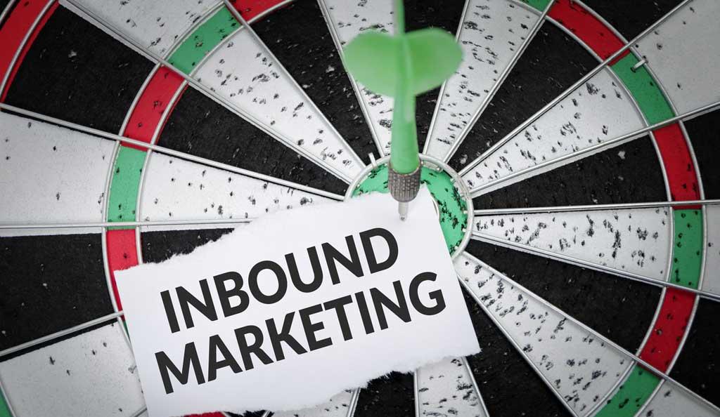 inbound marketing sign stuck to a dart board