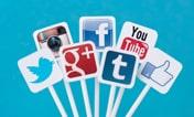 seven social media platform logos printed on signs