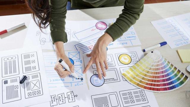 woman choosing colors for a web design