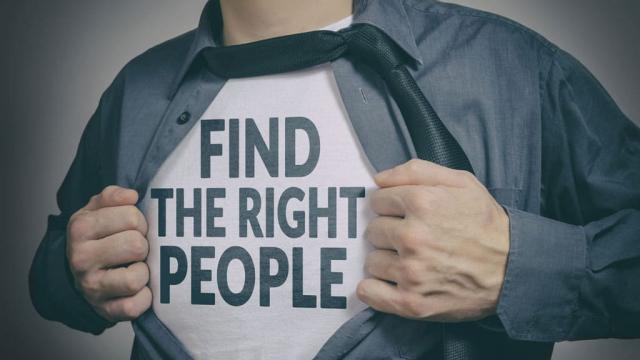 man opening shirt revealing a message,