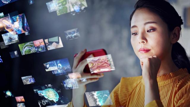 woman watching videos on smart phone